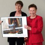 Nola Ruth and Jennie Cummings holding Missouri Arts Award poster, 2015